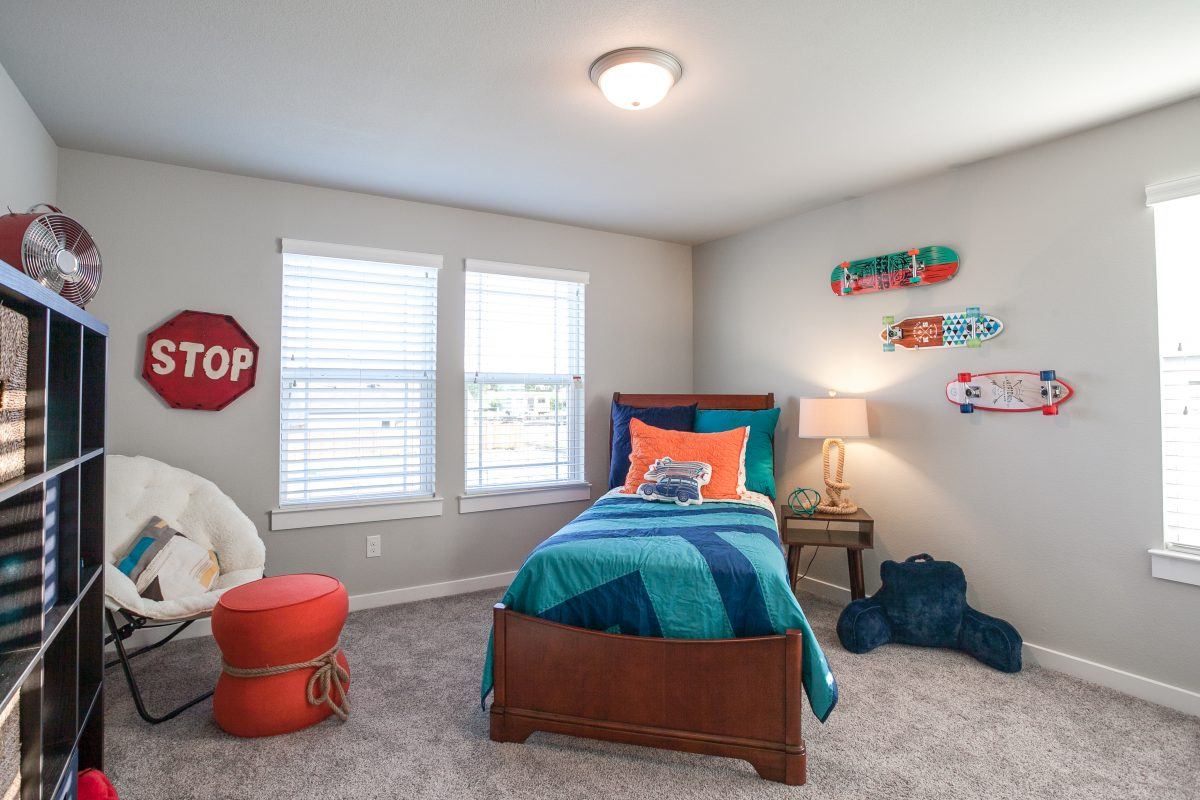 Newly decorated boys bedroom in a new home for sale in denton tx