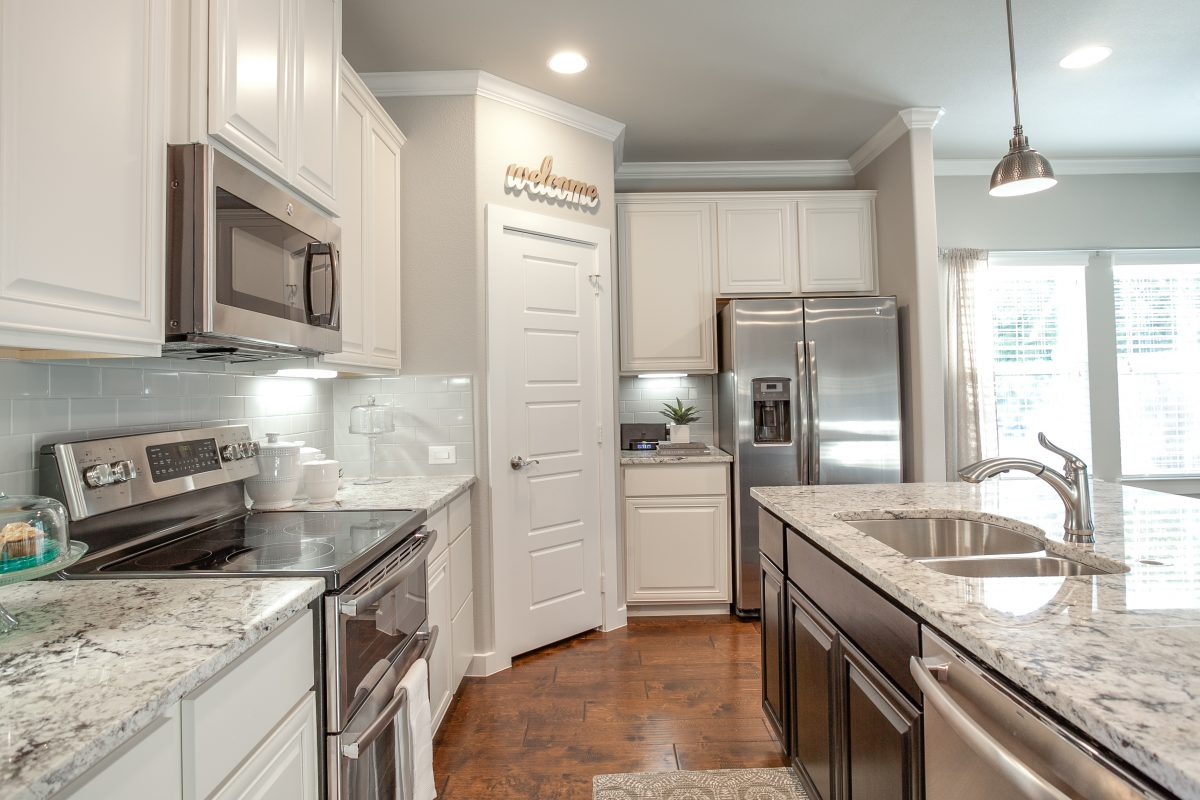 Beautifully decorated new kitchen with upgraded stainless steel appliances