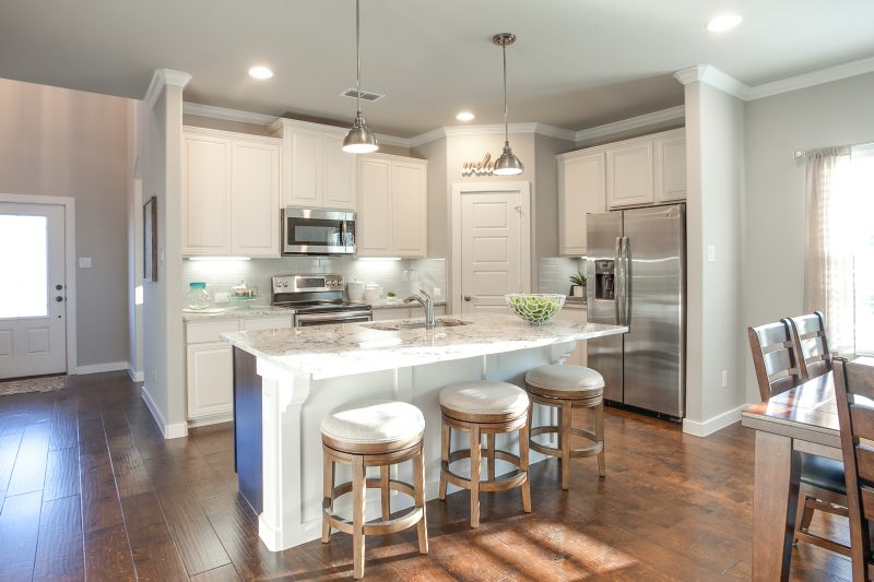 New kitchen with modern appliances and granite counter